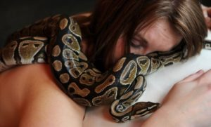 woman sleeps with her snake