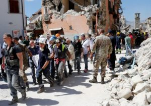 A-body-is-carried-away-by-rescuers-following-an-earthquake-in-Amatrice